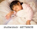 little child girl sleeping in...   Shutterstock . vector #687768658