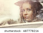 sad woman looking out window... | Shutterstock . vector #687778216