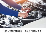 hands of car mechanic with... | Shutterstock . vector #687785755