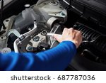 hands of car mechanic with... | Shutterstock . vector #687787036