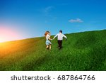 young happy lovers running on... | Shutterstock . vector #687864766