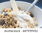pouring milk in a bowl of... | Shutterstock . vector #687959452