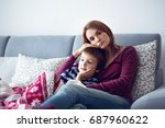 young mother  holding her... | Shutterstock . vector #687960622