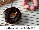 pink donuts and chocholate donut | Shutterstock . vector #688007416