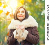 young woman posing in autumn... | Shutterstock . vector #688024726