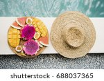 shot from above of straw hat... | Shutterstock . vector #688037365