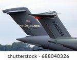 Small photo of FAIRFORD, UNITED KINGDOM - JULY 16, 2017: Airbus A400 of Airbus Military and Boeing C-17 Globemaster of United States air force tails at Royal International Air Tattoo show at Fairford AFB