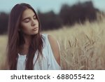 sad lonely young girl in a... | Shutterstock . vector #688055422