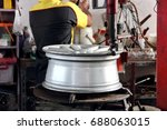 alloy car wheel on repair car... | Shutterstock . vector #688063015