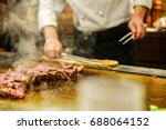 hand cooking wagyu beef  famous ... | Shutterstock . vector #688064152