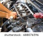 hand of car mechanic working in ...   Shutterstock . vector #688076596