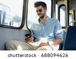 man in the bus listens to music. | Shutterstock . vector #688094626