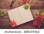 maple leaf on wooden background ... | Shutterstock . vector #688105462