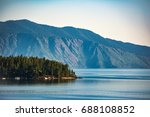 Small photo of An inhabited Island looking across Lake Pend Oreille, Idaho U.S.A.