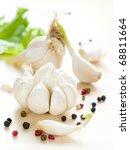 Fresh garlic on kitchen table - stock photo