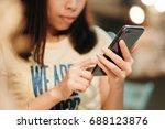 hand of woman using smartphone... | Shutterstock . vector #688123876