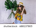 teen girl with tropical leaves...