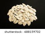 pumpkin seeds on black... | Shutterstock . vector #688159702