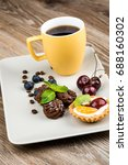cup of coffee and pastry on... | Shutterstock . vector #688160302