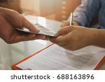 man offering batch of hundred... | Shutterstock . vector #688163896