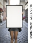 girl holds a frame on the... | Shutterstock . vector #688172248