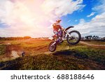 Racer On Mountain Bike...