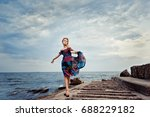the girl in a colorful dress on ... | Shutterstock . vector #688229182