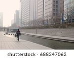 man is walking down the street... | Shutterstock . vector #688247062