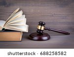wooden gavel and books in... | Shutterstock . vector #688258582