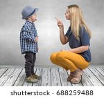 a young mother scolds her... | Shutterstock . vector #688259488