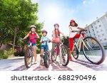 happy children with bicycles in ... | Shutterstock . vector #688290496