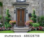 front door with flowers | Shutterstock . vector #688328758