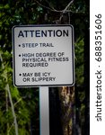 Small photo of An attention steep trail sign with additional warnings.