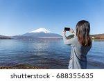 Woman Taking Photo On Fujisan