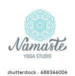 namaste. yoga studio logo with... | Shutterstock .eps vector #688366006