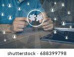 man holding pieces of jigsaw... | Shutterstock . vector #688399798