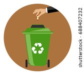 the hand throws the garbage... | Shutterstock .eps vector #688407232