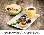 cup of coffee and pastry on... | Shutterstock . vector #688411648