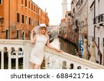 girl in a hat walks at dawn in... | Shutterstock . vector #688421716