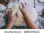 close up view of baker kneading ... | Shutterstock . vector #688434622