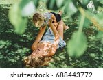 a young beautiful mother fools... | Shutterstock . vector #688443772