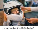 child in a motorcycle helmet   Shutterstock . vector #688446766