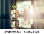 plant growing out of coins with ... | Shutterstock . vector #688521436