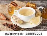 a white cup of green natural... | Shutterstock . vector #688551205