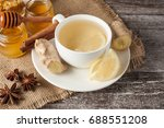 a white cup of green natural... | Shutterstock . vector #688551208
