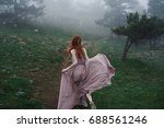 a woman runs in the woods in...   Shutterstock . vector #688561246