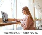 girl freelancer sitting working ... | Shutterstock . vector #688572946