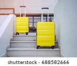 two yellow suitcases on the... | Shutterstock . vector #688582666