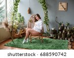 home cozy portrait of pregnant... | Shutterstock . vector #688590742
