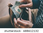 Girl's Hands Holding Dollar...